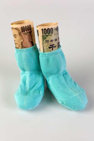 care allowance: children socks with japanese yen bank notes