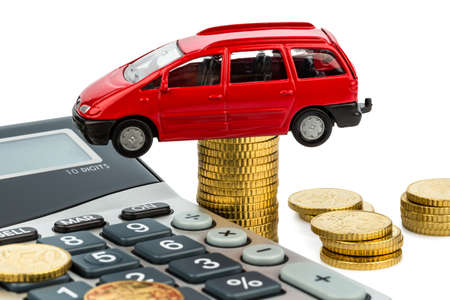car and calculator  rising costs for car sales, leasing, workshop, refueling and insurance photo