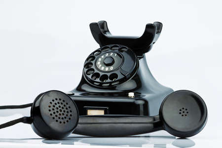 an old antique telephone  isolated and released on a white background photo