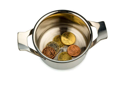 monetary policy: a few euro coins in a pot, symbol photo for sovereign debt and financial needs