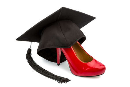 gender equality: a red ladies shoes on a mortarboard, symbol photo for gender equality and women power Stock Photo