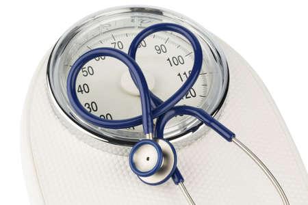 obesidad: estetoscopio y foto equilibrio s�mbolo para el peso, la dieta y las enfermedades del coraz�n