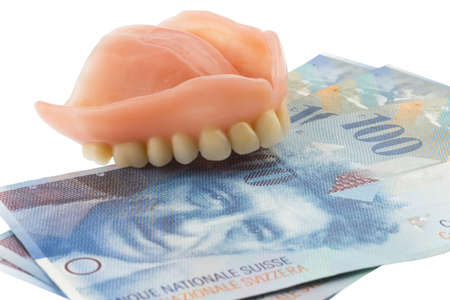 dentition: dentition and the swiss franc symbol photo of dentures, treatment costs and payment Stock Photo