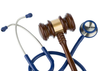 medical choice: gavel and stethoscope, symbol photo for bungling and medical error Stock Photo