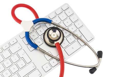 edv: stethoscope and a computer keyboard, symbolic photo for diagnosis and event management
