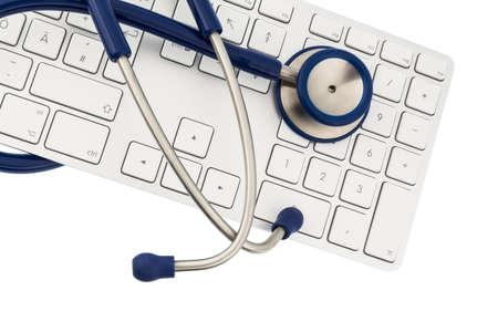 stetoscopio e tastiera di un computer, foto simbolico per la diagnosi e la gestione degli eventi