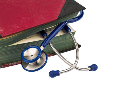 book and stethoscope, symbol photo for bungling, doctors mistake and expertise photo