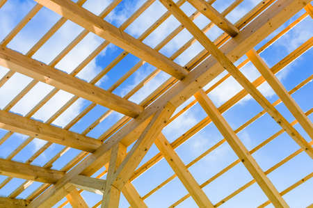 roof beam: wooden roof construction, symbolic photo for home, home construction, and home financing