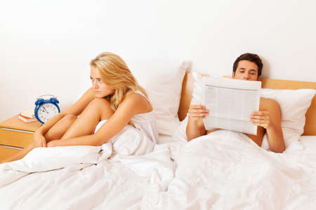 dear: a young couple in bed has problems and crisis  divorce and separation