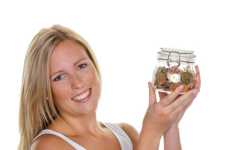 a young woman saves money and coins for the future  preparedness and save  photo