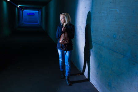 underpass: a young woman in an underpass for pedestrians fear of harassment and crime