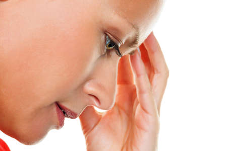 burn out: a thoughtful young woman with headaches and migraines  Stock Photo