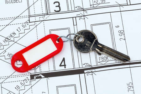 an architect s blueprint with the key of an apartment or a new house photo