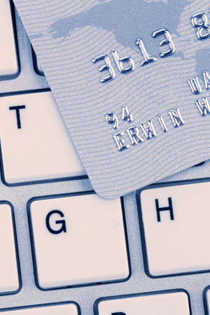 cashless: closeup of a credit card for cashless payment and keyboard  symbolic for shopping on the internet