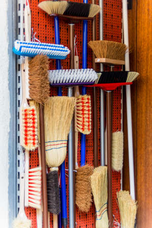 special service agent: cabinet with different types of brooms