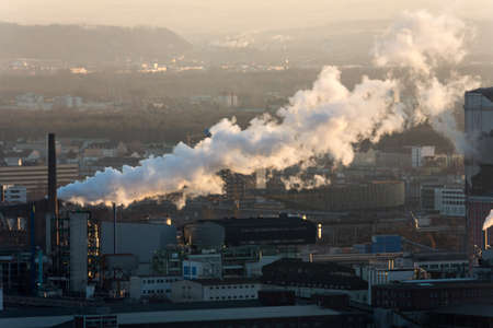 particulate: industrial plant in upper austria, symbolic photo for air pollution and climate change