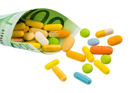 tablets and one hundred euro banknote symbolic cost of medicine and drugs in the pharmaceutical industry Stock Photo - 19088850