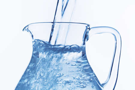 consumables: pour water in a carafe, symbol for drinking water, refreshments, supplies and consumables
