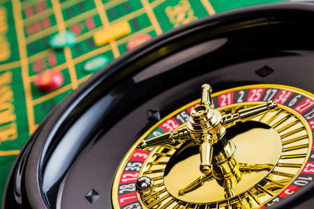 the cylinder of a roulette gambling in a casino  profit and loss is decided by chance  photo