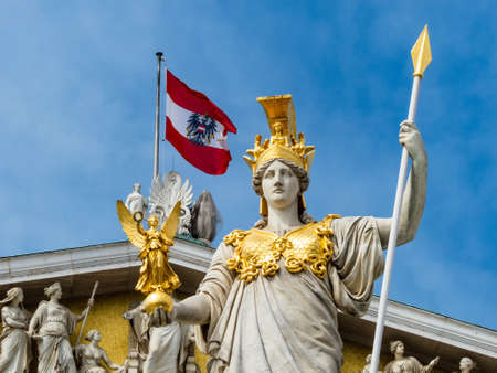 athene: the parliament in vienna, austria  with the statue of  pallas athena  of the greek goddess of wisdom  Stock Photo