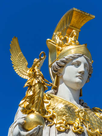 pallas: the parliament in vienna, austria  with the statue of  pallas athena  of the greek goddess of wisdom  Stock Photo