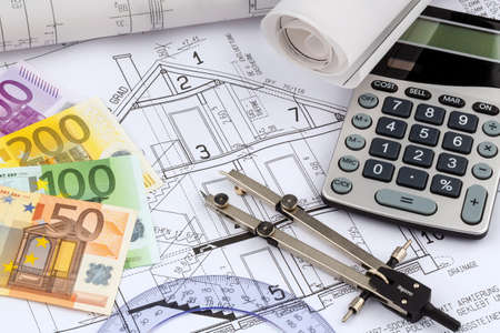 single familiy: an architect s blueprint with a calculator and euro money  symbolic photo for funding and planning of a new home