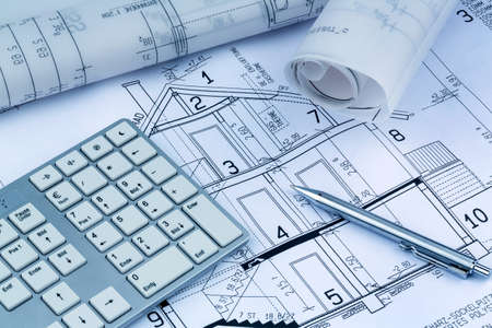 an architect s blueprint for the construction of a new residential house  symbolic photo for funding and planning of a new home  photo