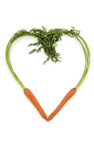 ein Herz aus biologisch angebauten Möhren frisches Obst und Gemüse ist immer gesund Symbolfoto für eine gesunde Ernährung