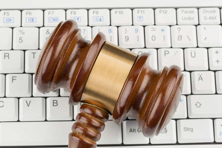 gavel on computer keyboard, symbolic photo for e-commerce and consumer protection photo
