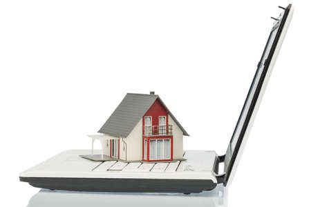 vacation home: building on computertastaur, symbol photo for real estate and housing market on the internet