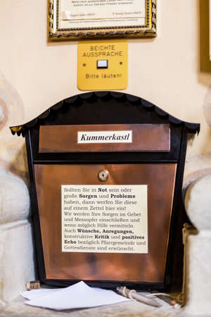 confessor: suggestion box at a church building Stock Photo