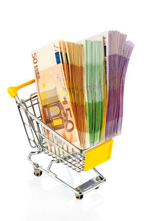 purchasing power: euro bills in a shopping cart photo icon for purchasing power, shopping, money printing and inflation