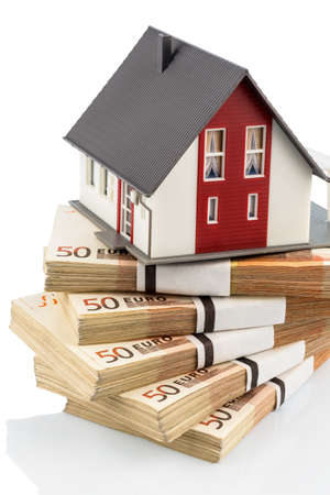 familiy: house on euro banknotes, symbolic photo for home purchase, financing, building society Stock Photo