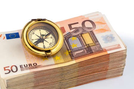hedging: compass on euro banknotes, symbolic photo for europe, monetary union and the outlook for the european currency