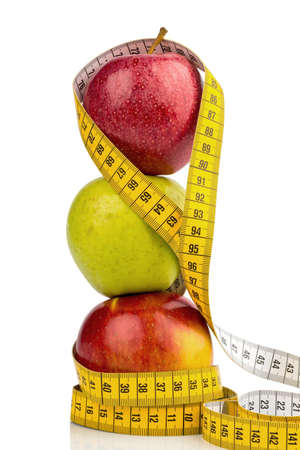 free background: several apples with a tape measure  symbolic photo for diet and healthy, vitamin-rich diet  Stock Photo
