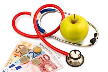 an apple and a stethoscope with a doctor  representative photo of healthy and vitamin-rich diet