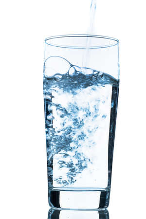 potable: water is poured into a glass, symbolic photo for drinking water, freshness, demand and consumption