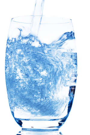 hydrology: water is poured into a glass, symbolic photo for drinking water, freshness, demand and consumption