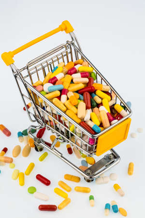 therapie: colorful tablets in the cart, photo icon for health costs, pharmacies, abundance of drugs