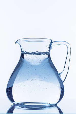 carafe: water in a jug, symbolic photo for drinking water, wealth, and consumption demand