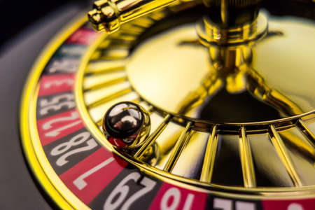 roulette player: the cylinder of a roulette gambling in a casino  winning or losing is decided by chance  Stock Photo