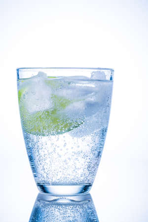 dehydrate: a glass of fresh drinking water and a lime  mineral water as a thirst quencher
