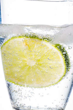 quencher: a glass of fresh drinking water and a lime  mineral water as a thirst quencher