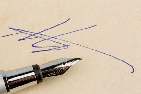 notieren: a contract or document is signed by hand with a fountain pen  Stock Photo