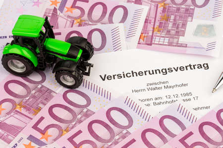 the contract of insurance for a new tractor  with pen and euro money  insurance for agriculture for hazards and hail photo