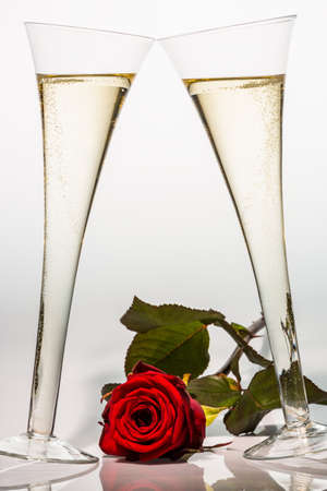 champagne or sparkling wine in a champagne glass with red rose  photo icon for celebrations, wedding anniversary, valentine s, birthday  photo
