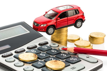 car and calculator  rising costs of car purchase, lease, workshop, refueling and insurance photo