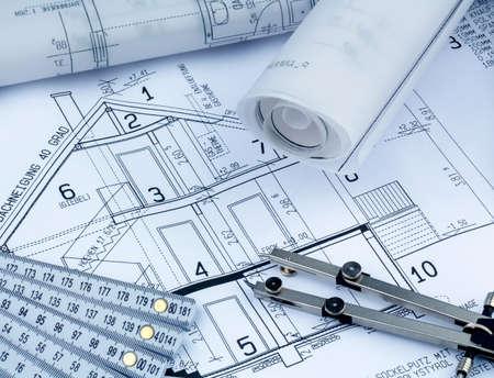 single familiy: proyecto a un arquitecto s para la construcci?n de una nueva casa residencial foto simb?lica de la financiaci?n y la planificaci?n de un nuevo hogar