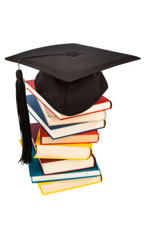 fees: a mortarboard on a book stack, symbol photo for education and skills
