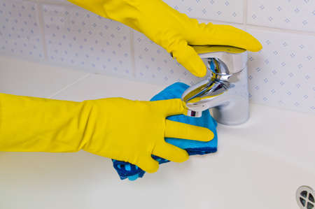 the sink of a bathroom is cleaned with latex gloves  Stock Photo - 19420342